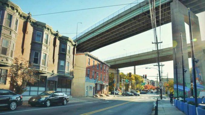 EastFallsLocal-LAST-YEAR-11-11-ridge-twin-bridges-rowhomes-sun-flare-vint-pm-1024x683-1-1024x683.jpg