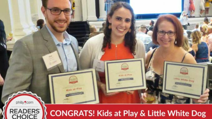 EastFallsLocal-barb-smiles-with-her-award-and-kids-at-play-exp-zoom-READERS-CHOICE-text-1024x768.jpg