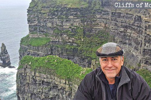 Eastfallslocal.Dr-Ron.Cliffs-of-Moher-w-Hat3-w-TEXT-1024x576.jpg