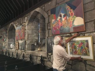George-puts-up-paintings-at-St-James.jpg