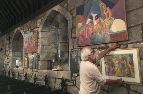George-puts-up-paintings-at-St-James.jpg
